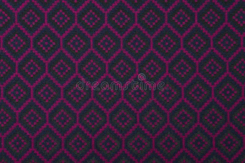 Materiaal in geometrische patronen, een textielachtergrond. royalty-vrije stock afbeelding