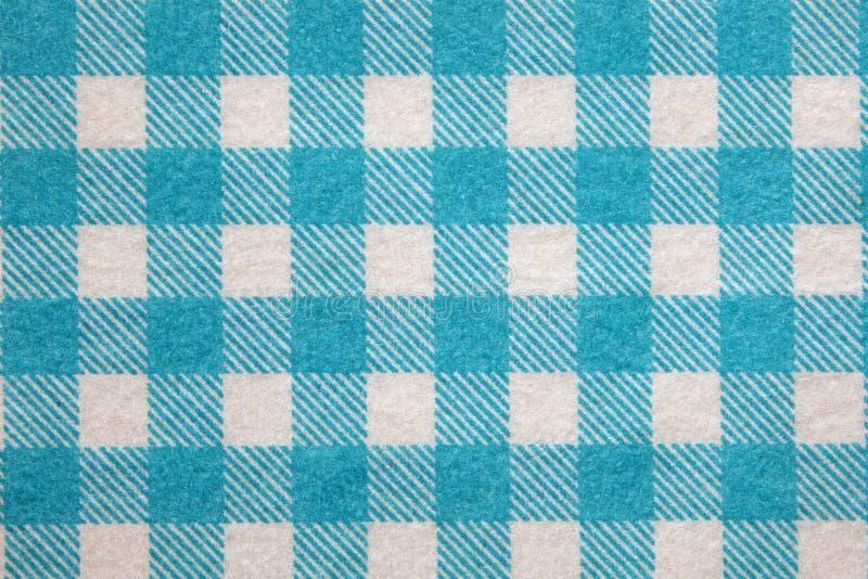 Material in blaues Gitter, Hintergrund. stockfotos