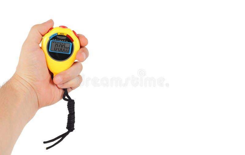 Material desportivo - cronômetro amarelo em uma mão fotos de stock royalty free