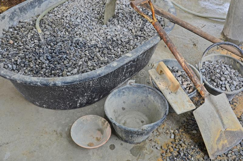 Material mixers and mason tools for concrete construction. On concrete floor of site stock photo