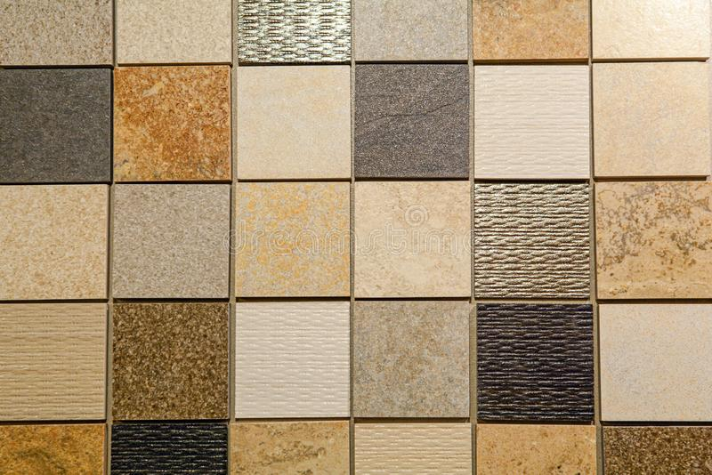 Material pattern with tiles and natural stone for bathroom and kitchen flooring and wall, planning for renovation interior work in. Material pattern with tiles royalty free stock photography
