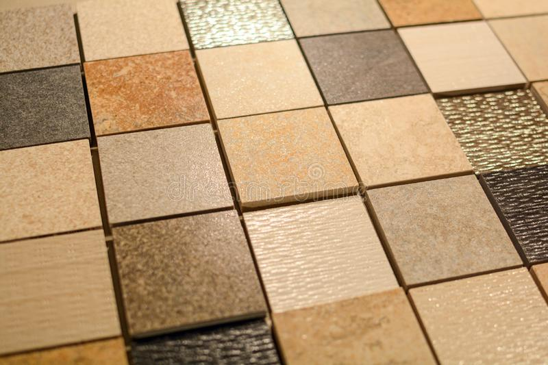 Material pattern with tiles and natural stone for bathroom and kitchen flooring and wall, planning for renovation interior work in royalty free stock image
