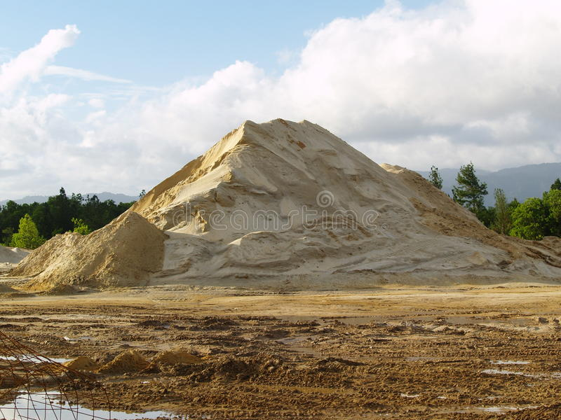 Material pile at a work site. A large mound of sand and/or gravel at a construction work site in Trinidad & Tobago in the Caribbean royalty free stock photography
