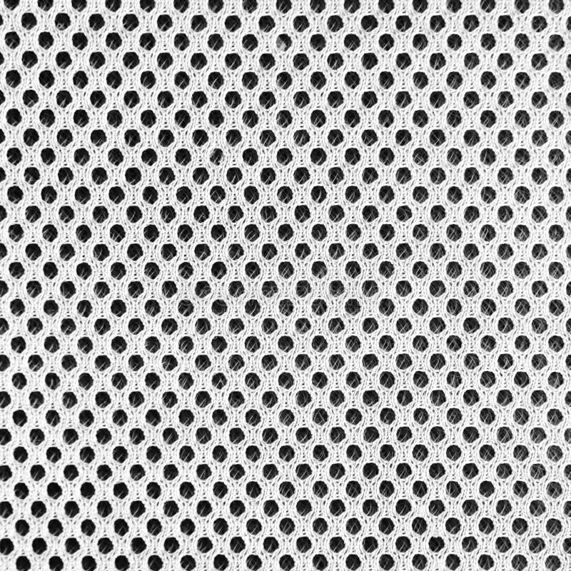 Material poriferous poroso respirável cinzento para a ventilação do ar com furos Textura branca preta do nylon do Sportswear quad imagens de stock