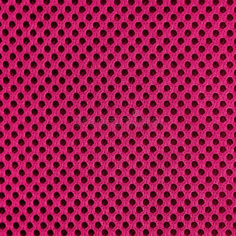 Material poriferous poroso respirável cor-de-rosa para a ventilação do ar com furos Textura de nylon material do Sportswear quadr fotos de stock
