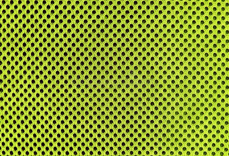 Material poriferous poroso respirável verde orgânico para a ventilação do ar com furos textura tropical do sportswear do cal fotos de stock royalty free