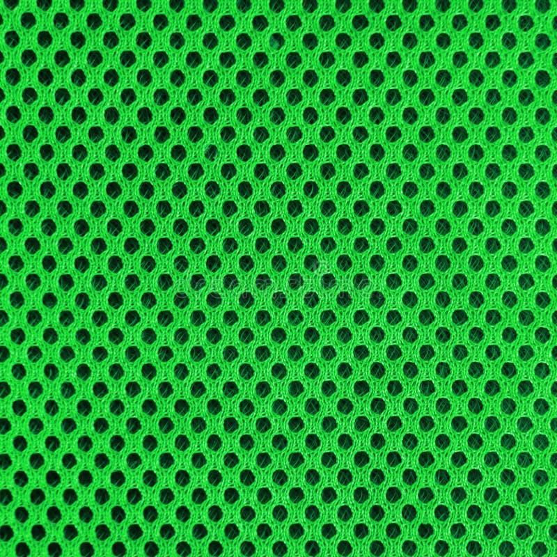Material poriferous poroso respirável verde para a ventilação do ar com furos Textura de nylon material do Sportswear quadrado fotos de stock