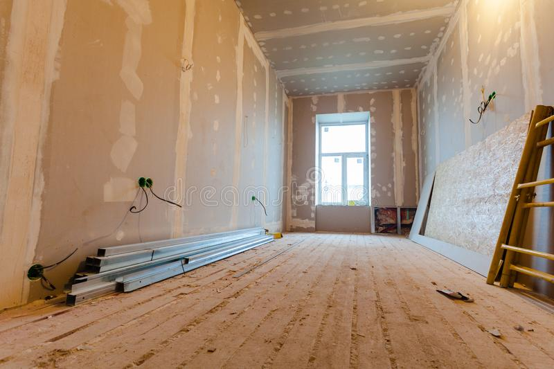 Material for repairs in an apartment is under construction, remodeling, rebuilding and renovation. Making walls from gypsum plasterboard or drywall stock photo