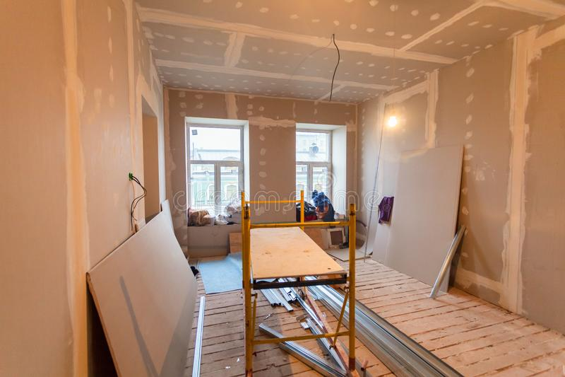 Material for repairs in an apartment is under construction, remodeling, rebuilding and renovation. Making walls from gypsum plasterboard or drywall royalty free stock photo