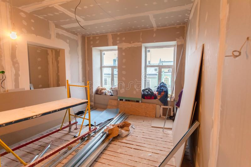 Material for repairs in an apartment is under construction, remodeling, rebuilding and renovation. Making walls from gypsum plasterboard or drywall stock photography