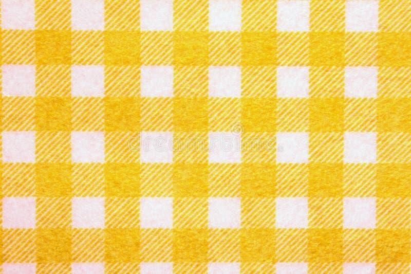 Materiale nella griglia gialla, un fondo. fotografia stock