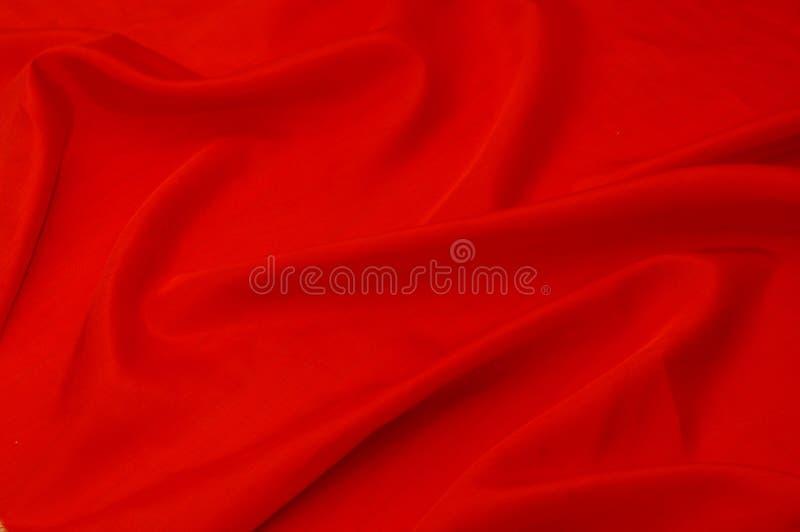 Materiale rosso della seta di struttura fotografie stock