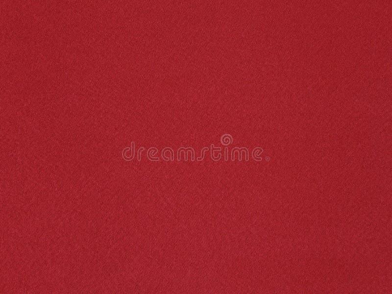 Materiale rosso solido del raso su vicino fotografia stock