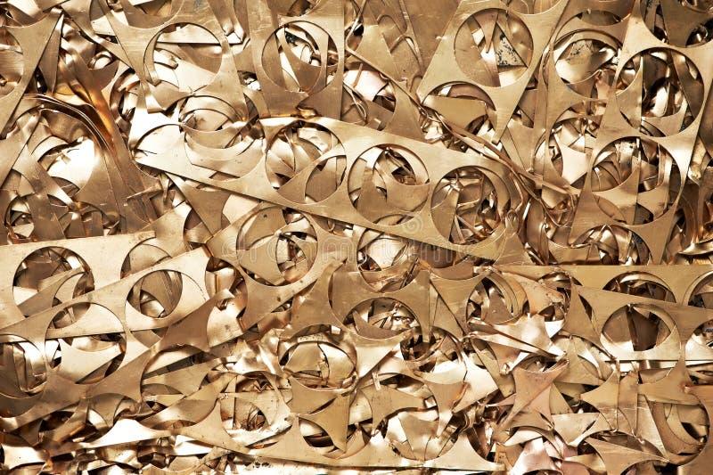 Materiales de cobre amarillo del desecho de metal que reciclan el backround foto de archivo
