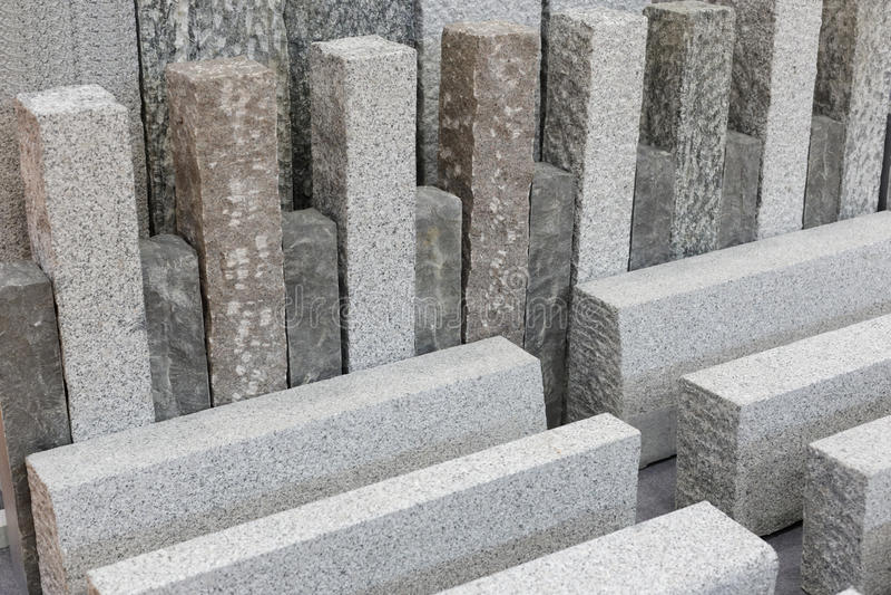 Materiali da costruzione della pietra grigia del granito fotografie stock libere da diritti