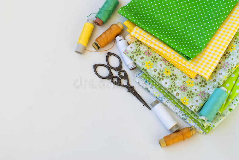 Materials at hand sewing on white stock photo