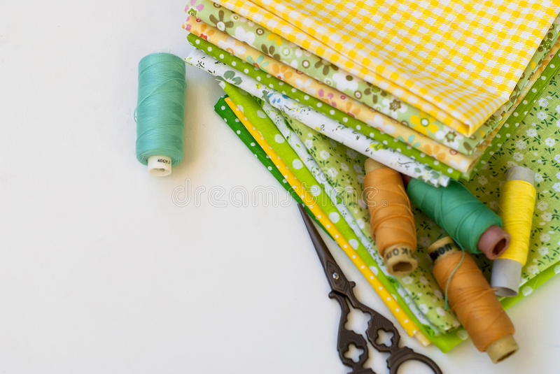 Materials at hand sewing on white. Sewing kit and cloth materials with dressmaking sewing utensils needlework concept stock image