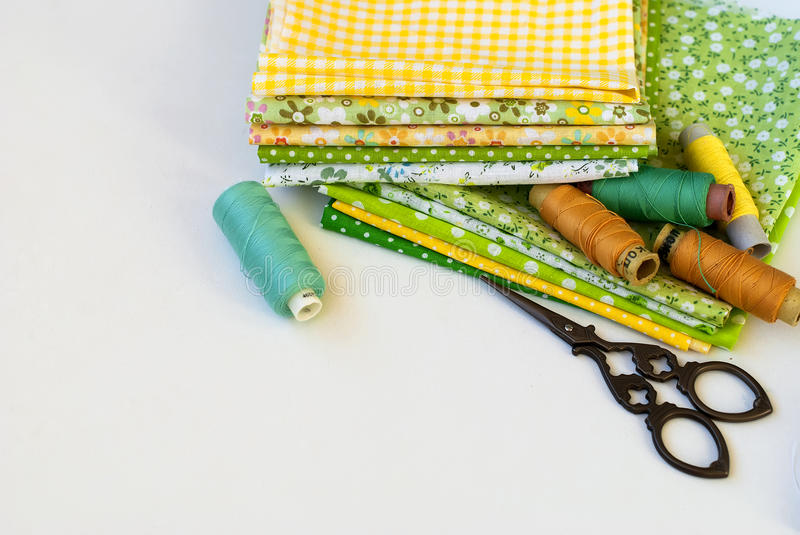 Materials at hand sewing on white. Sewing kit and cloth materials with dressmaking sewing utensils needlework concept royalty free stock images