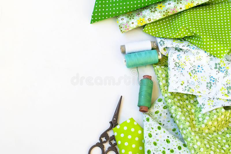 Materials at hand sewing on white. Sewing kit and cloth materials with dressmaking sewing utensils needlework concept royalty free stock image