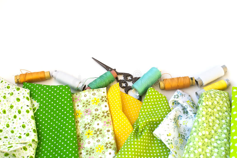 Materials at hand sewing on white. Sewing kit and cloth materials with dressmaking sewing utensils needlework concept stock photography