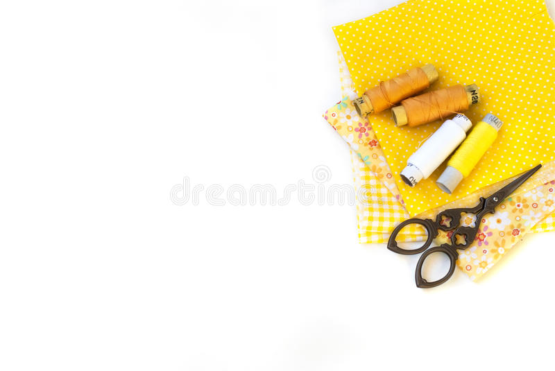 Materials at hand sewing on white. Sewing kit and cloth materials with dressmaking sewing utensils needlework concept stock photos