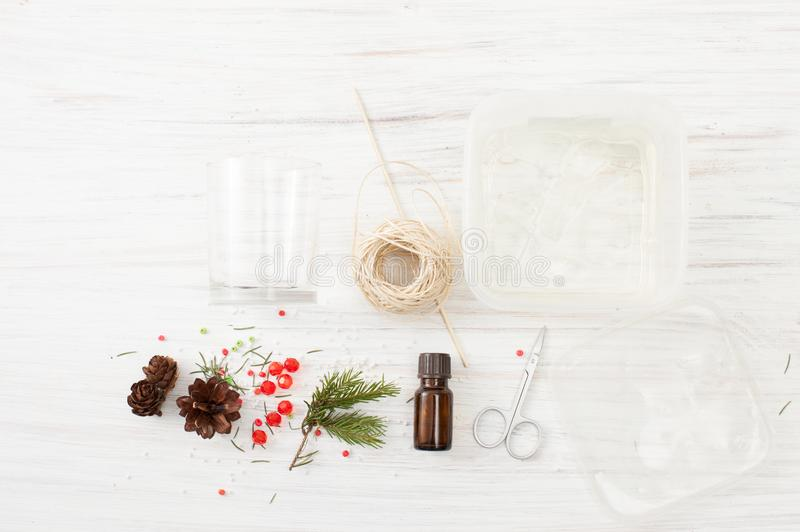 Materials for making gel candles on a white table. Homemade crafts with your kids for new year or Christmas. Gifts with your own hands. The place to insert the royalty free stock photos