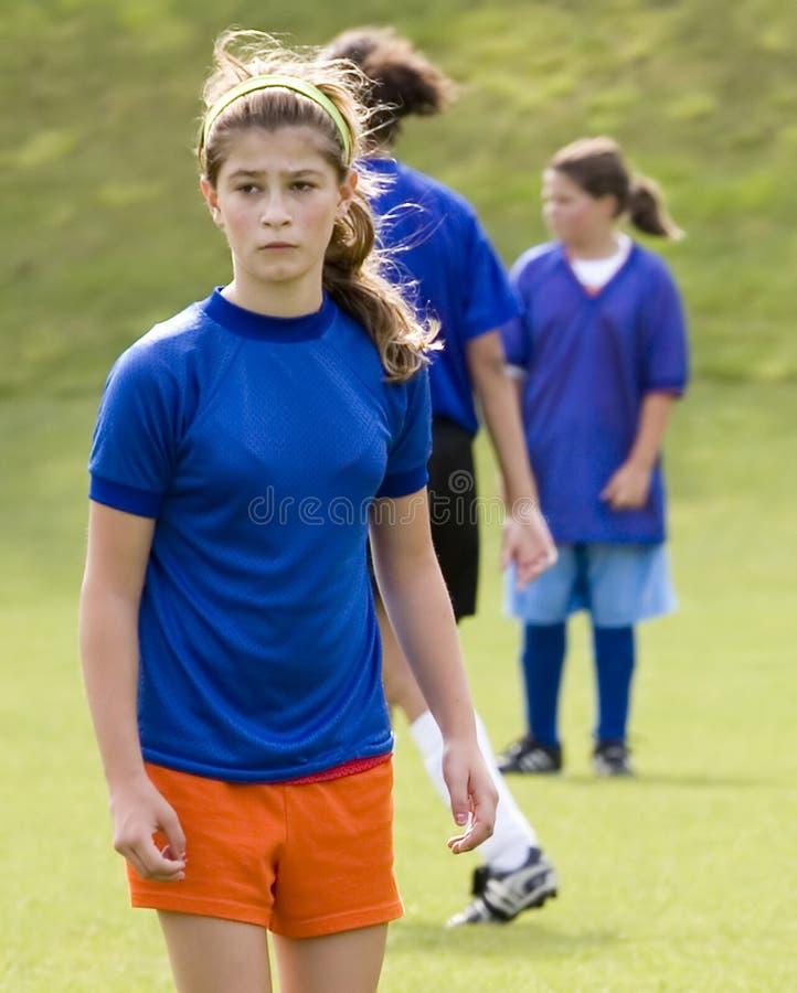 materiel för fotboll för kvinnligfotospelare royaltyfria foton