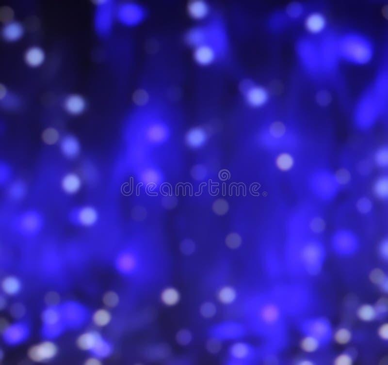 Materiel-foto-blått-ljus-bokeh-defocused-abstrakt begrepp-bakgrund royaltyfri bild