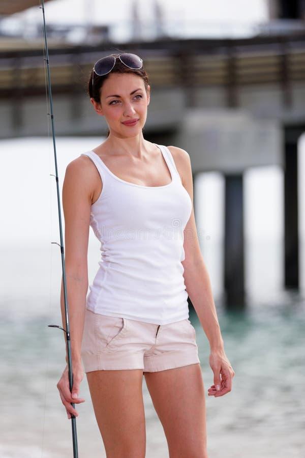 Materielbild av en fisherkvinna royaltyfri foto