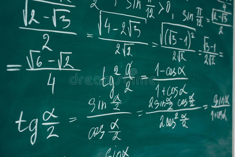 Math class. Algebra. The formulas are written on the school board royalty free stock images