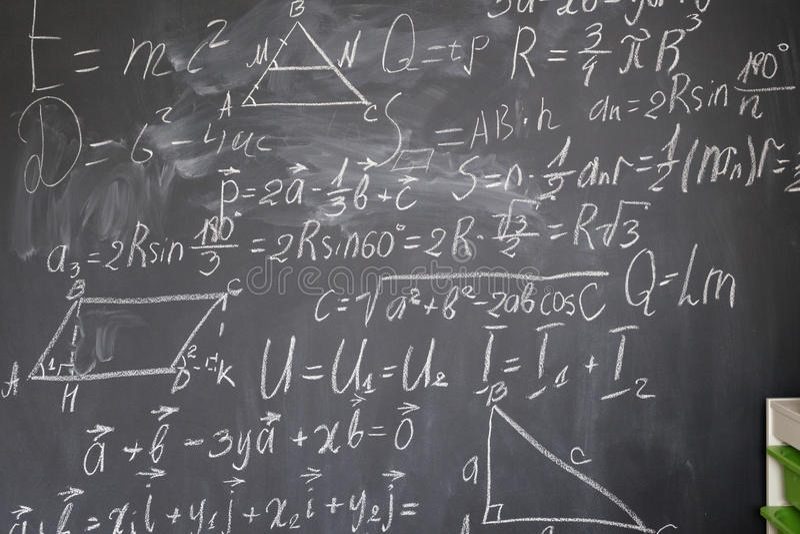 Math formulas on black board stock photos