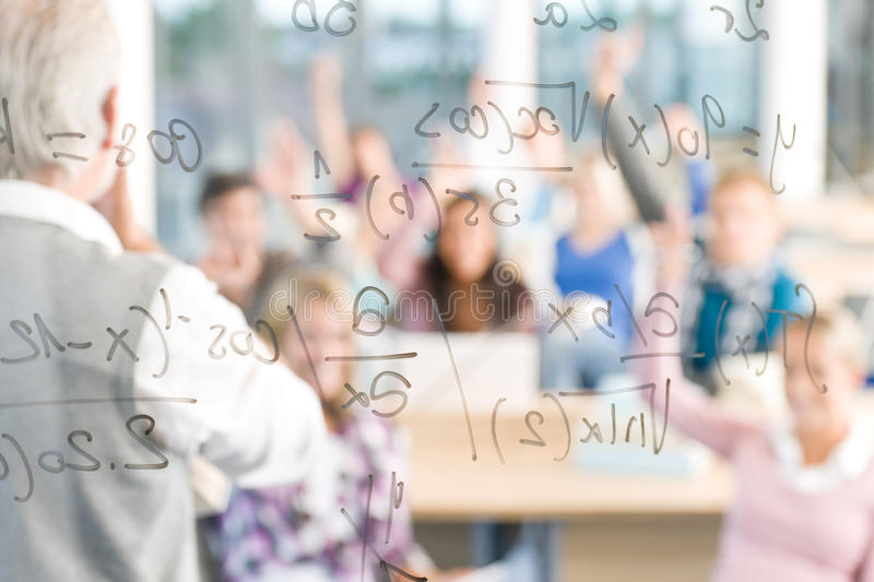 Math at high school - students with professor royalty free stock photos