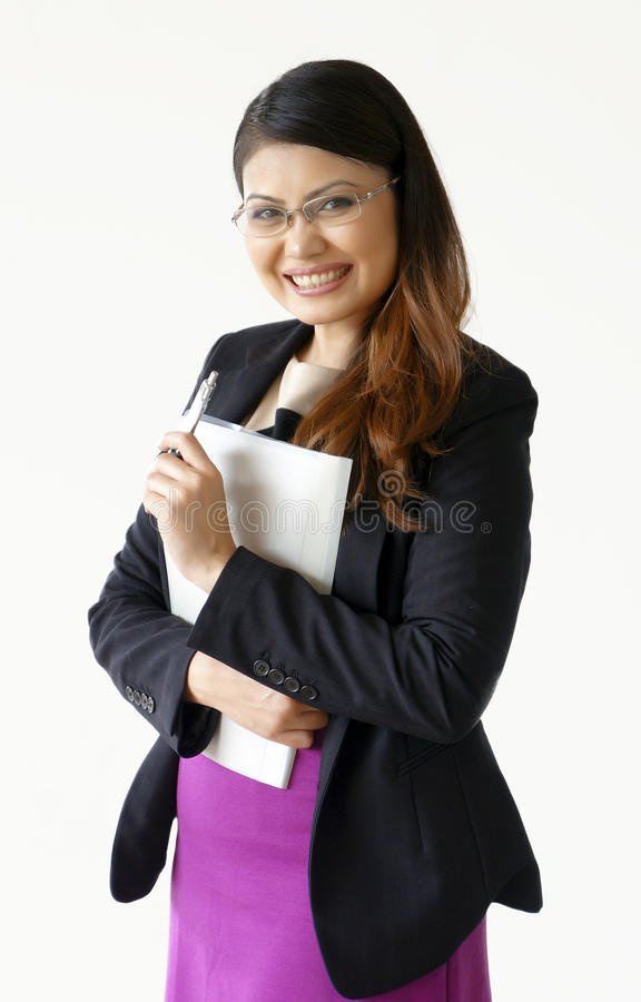 Math Teacher. Gorgeous Math teacher smiling while holding pen and files royalty free stock photography
