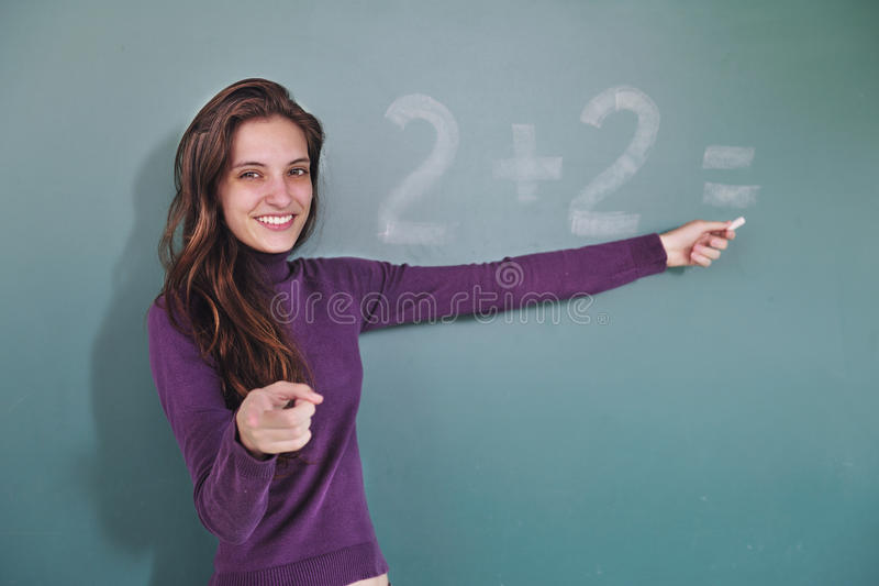 Math teacher in front of blackboard stock photography
