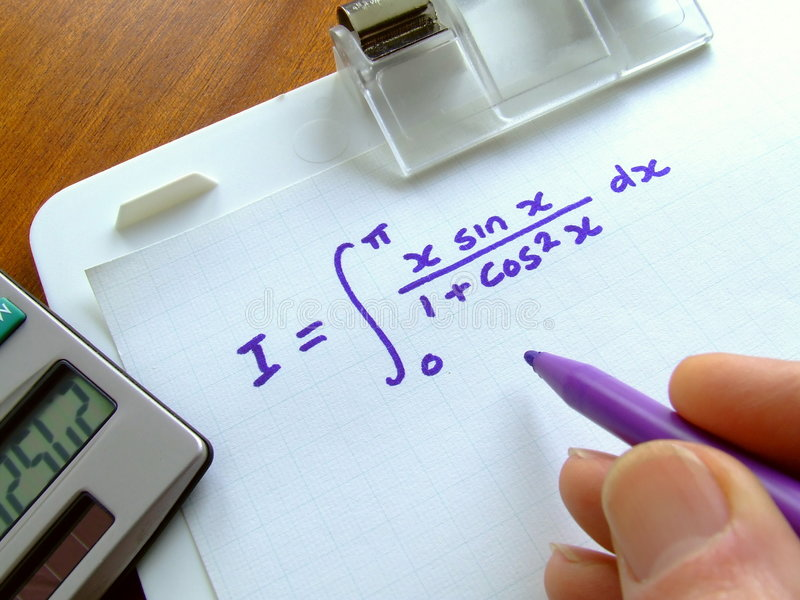 Mathematical Equation. Close-up of a clipboard on which a calculus integration equation has been written royalty free stock images