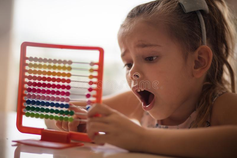 This mathematics is very difficult. Little girl learning. Close up royalty free stock image
