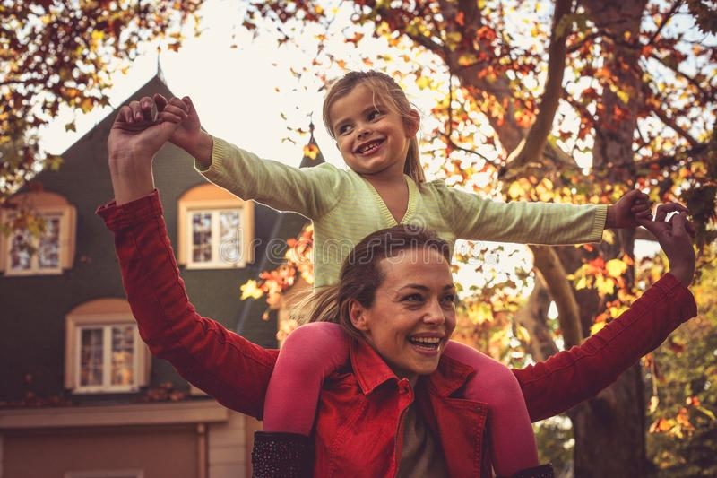 Mather with daughter enjoy in autumn season. stock images