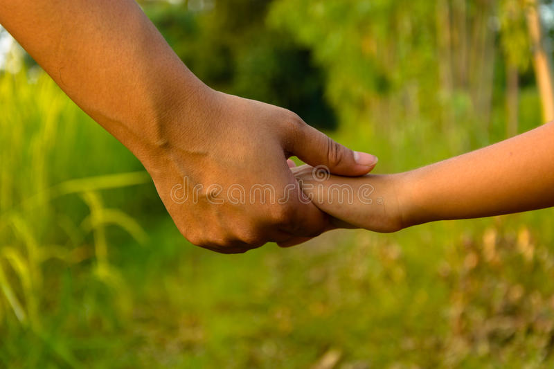 Mather giving hand to a child royalty free stock image