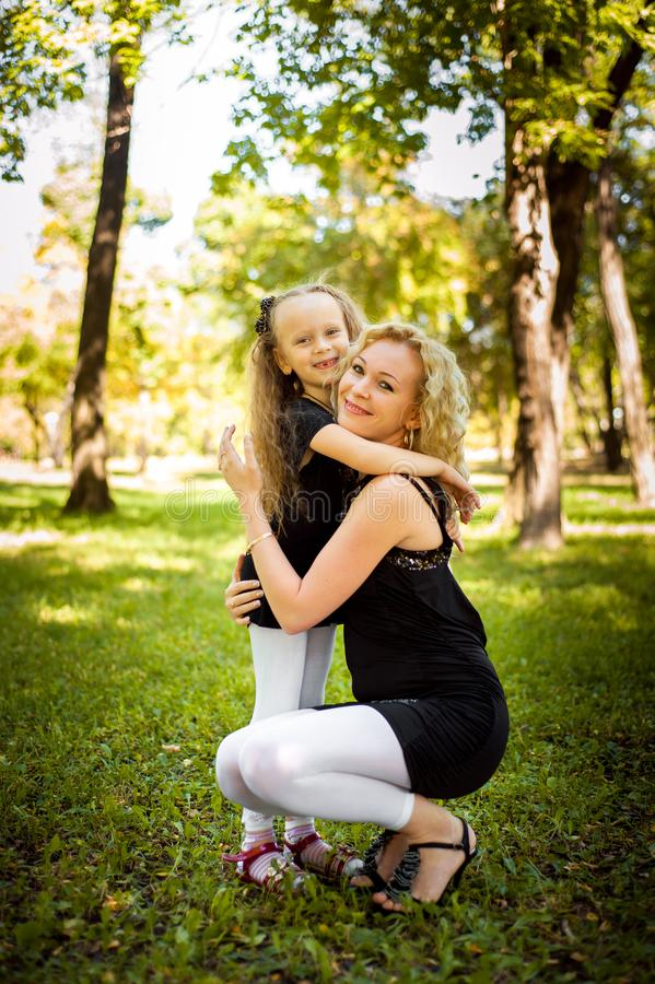 Mather and her daughter in the park. Mather and her daughter in the park stock photography