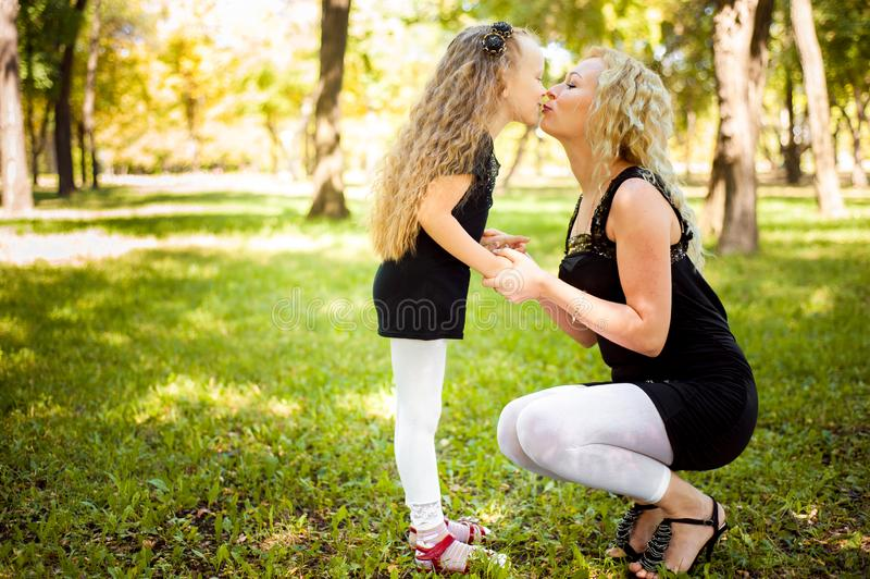 Mather and her daughter in the park. Mather and her daughter in the park royalty free stock images
