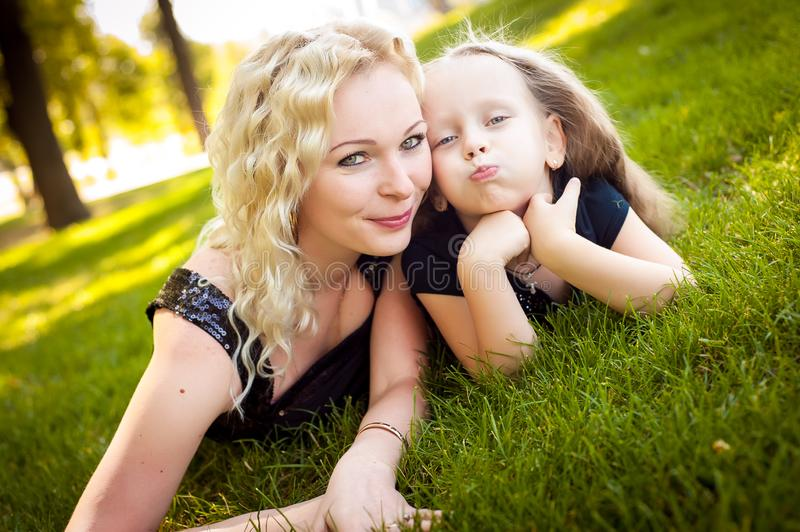 Mather and her daughter in the park. Mather and her daughter in the park royalty free stock photo
