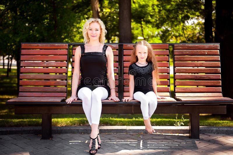 Mather and her daughter in the park. Mather and her daughter in the park royalty free stock photos
