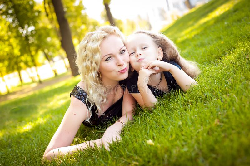 Mather and her daughter in the park. Mather and her daughter in the park stock image