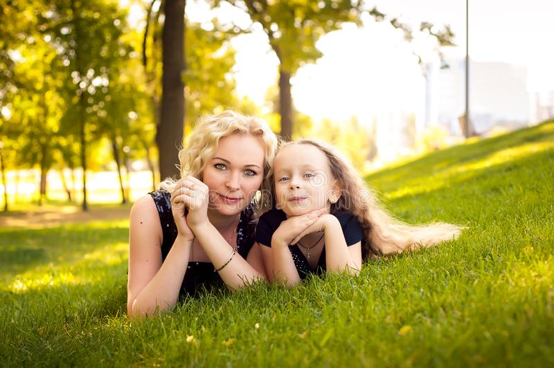 Mather and her daughter in the park. royalty free stock images