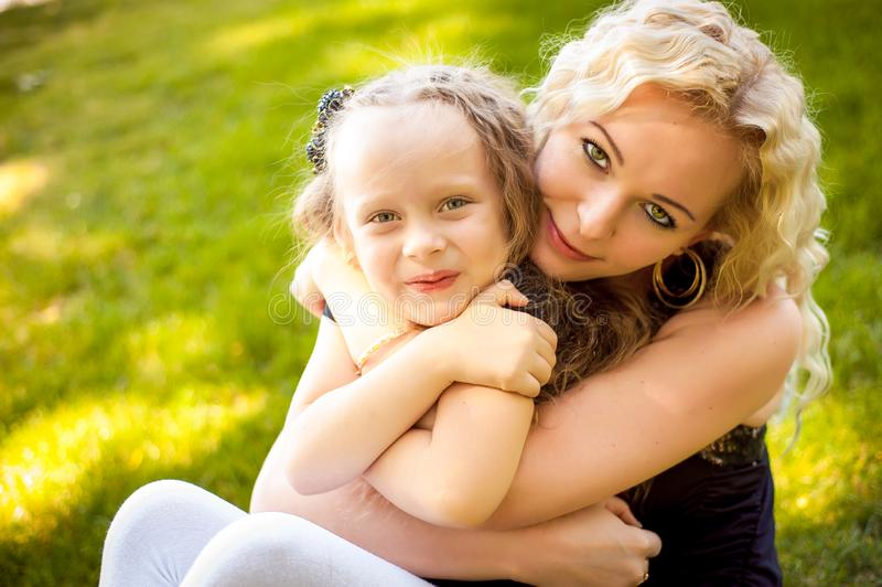 Mather and her daughter in the park. stock photography