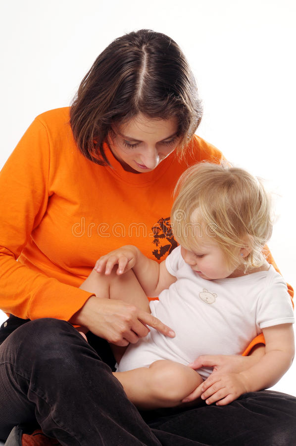Download Mather In Orange T-shirt With Little Blonde Girl Stock Image - Image: 15067495