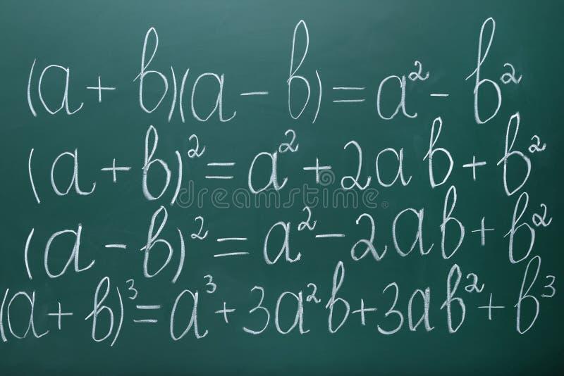 Maths formulas. On chalkboard background royalty free stock photo