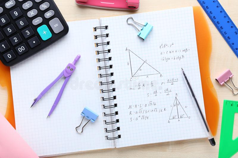 Maths formulas. Exercise book with maths formulas and school supplies stock photo