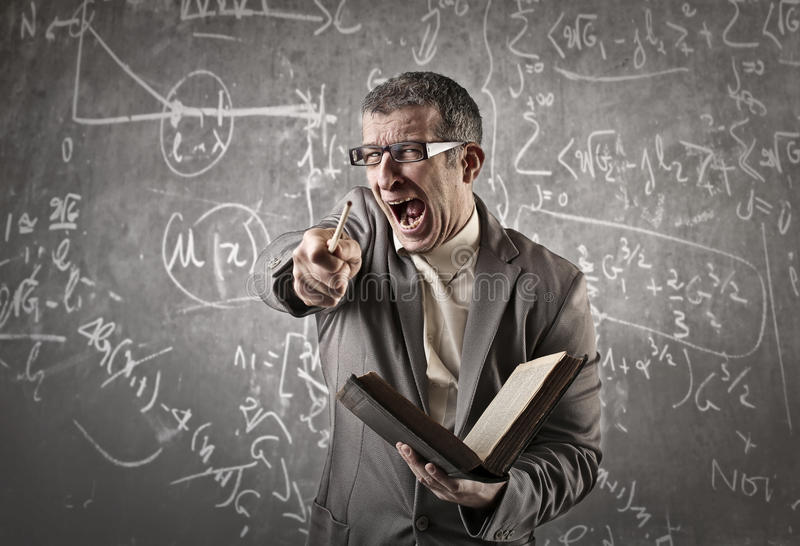 Maths teacher pointing at someone. Maths professor laughing and pointing at someone stock photography