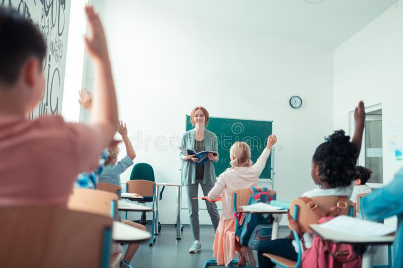 Maths teacher smiling to her class at the lesson. royalty free stock photos